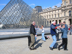 Suncoasters dancing at the Louvre in Paris