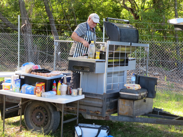 Franco cooking lunch on the trailer BBQ.