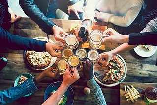 Friends toasting with craft beer.webp