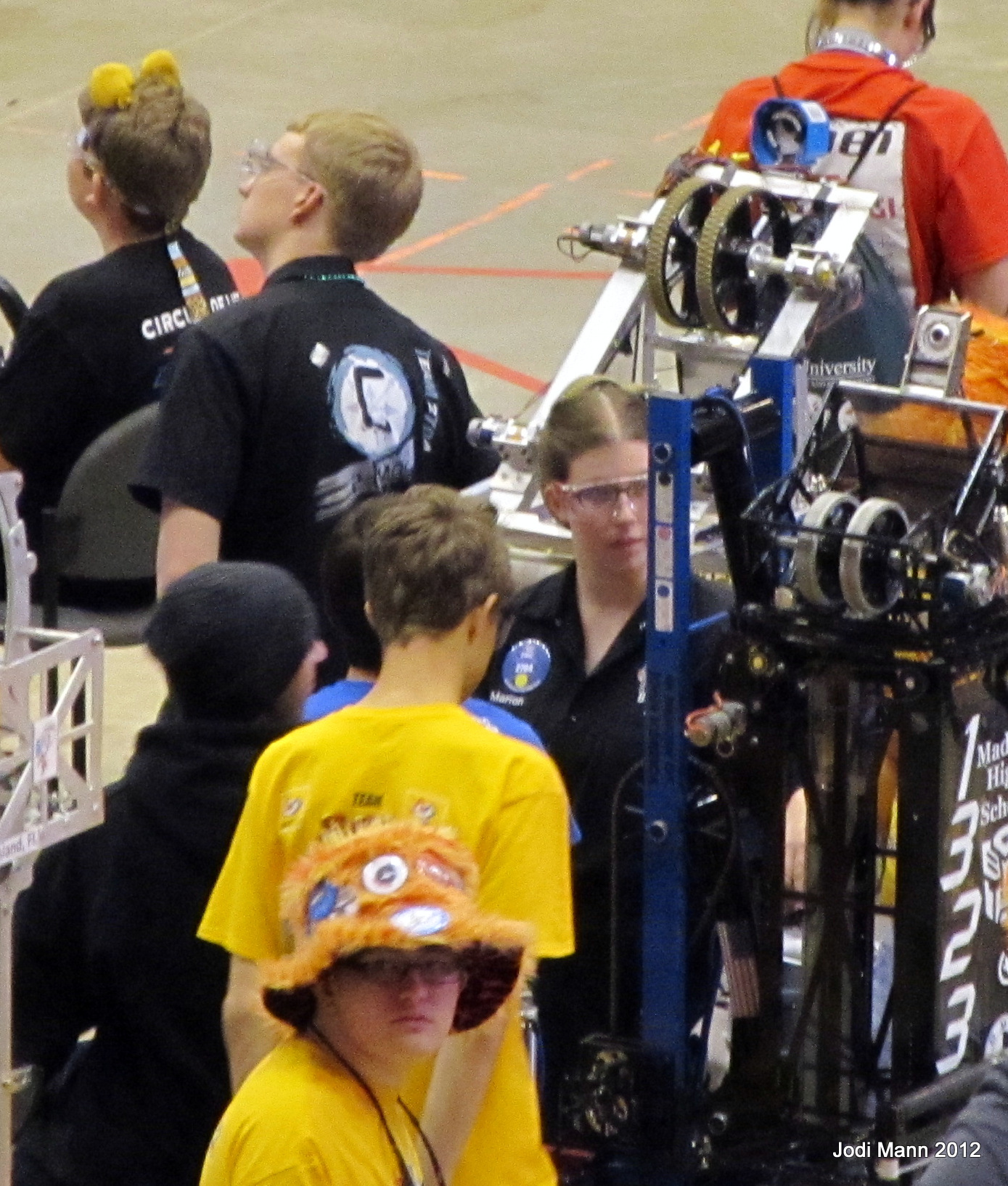 Students checking out a robot