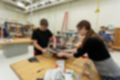 Students working on a robot in the high school shop, June 2016.