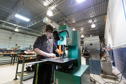 Student using a band saw