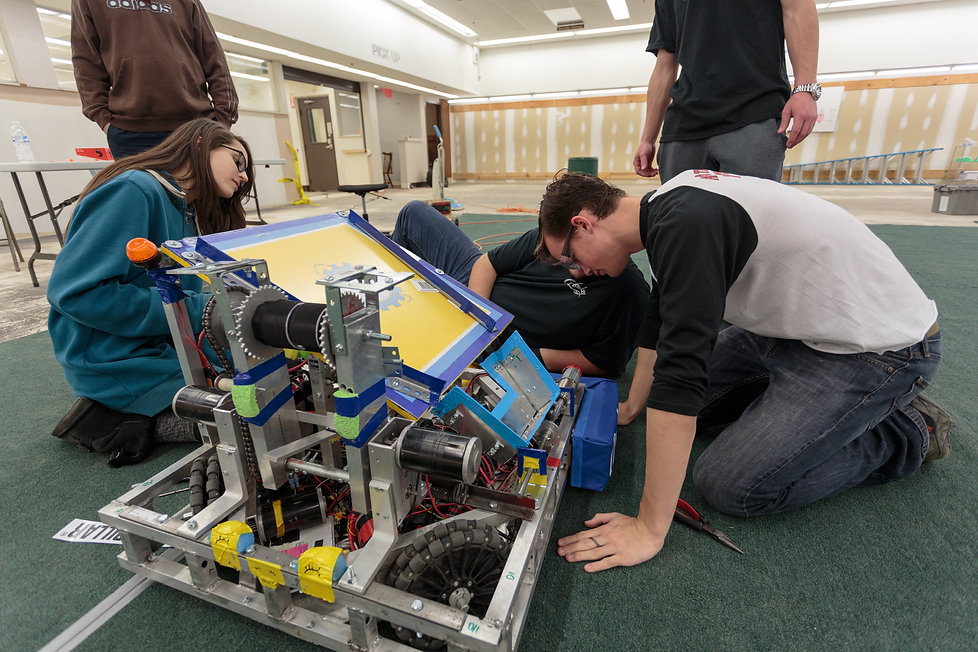 Students puting finishing touches on a robot before bagging it for competition, February 2017.