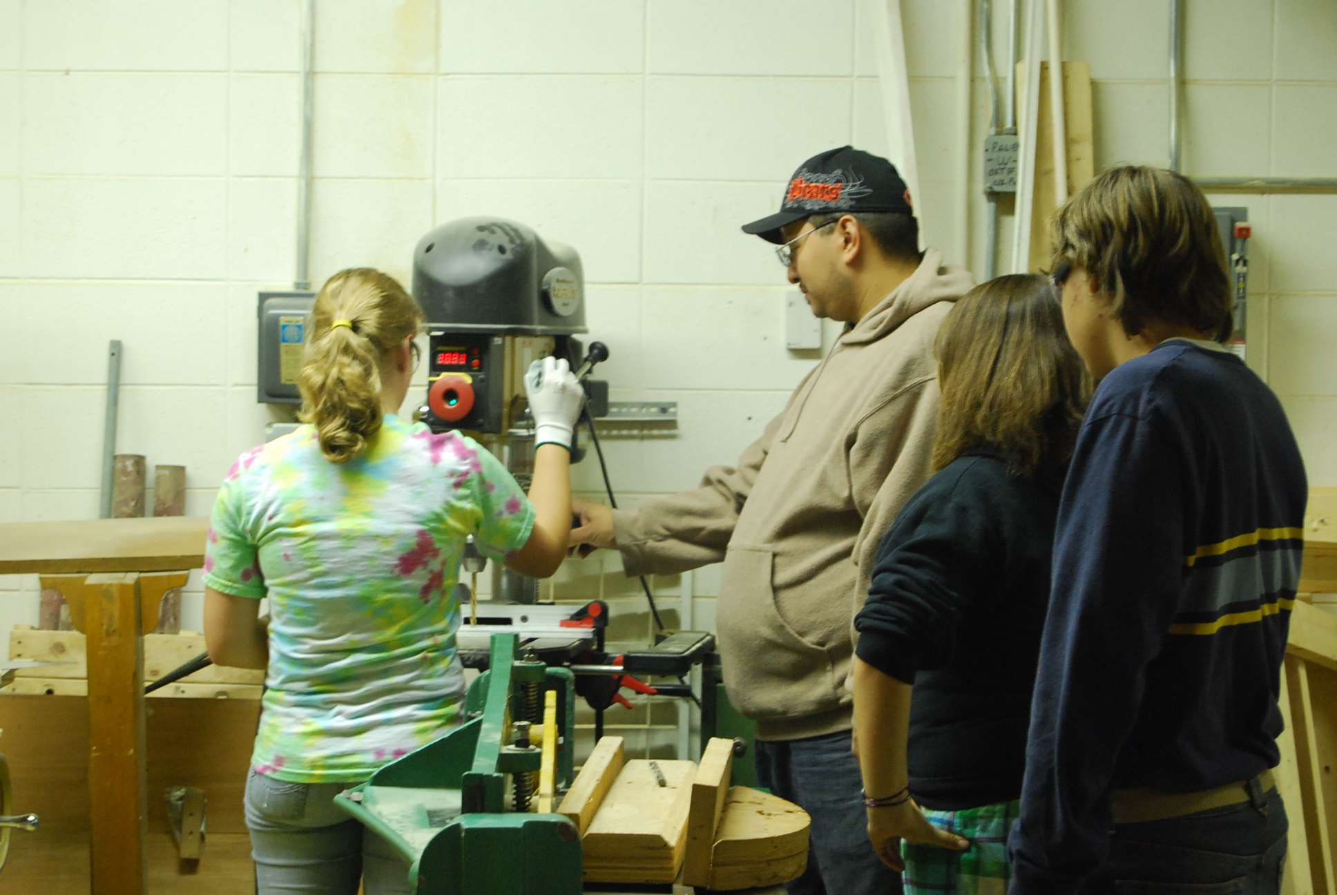 Student using a drill press.