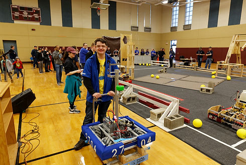 A Roaring Robotics student and robot at the field for the Robotis Extravaganza.