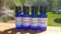 4 bottles  of essential.jpg