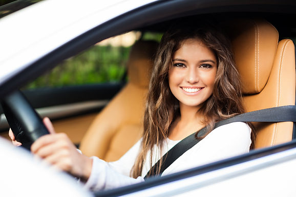 Young woman driving her car.jpg