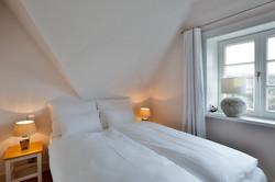 Kleines Schlafzimmer im DG