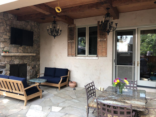 Flagstone Patio with Reclaimed Wood Ceiling