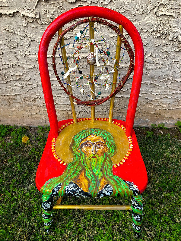 Portrait painted on chair. Mixed media dream catcher on chair back.