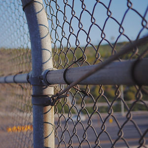 A fence demonstrating immigration