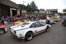 Rally cars by barn.jpg