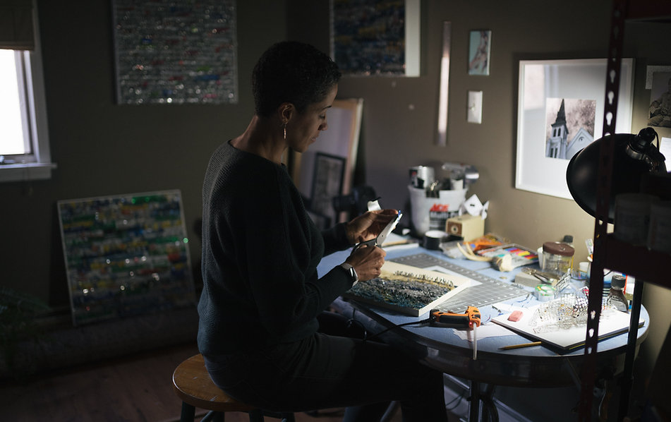 Artist Christina Hunt Wood works in her studio
