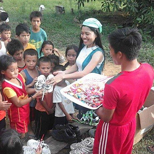 Giving of shoes and food to kids
