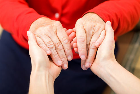Close up of 2 people holding hands