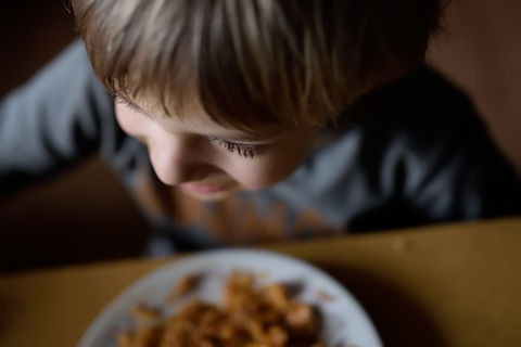 child eating at a table