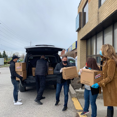 Volunteers moving food boxes at MAZON Covid emergency grantee Operation Ramzieh in Ottawa .