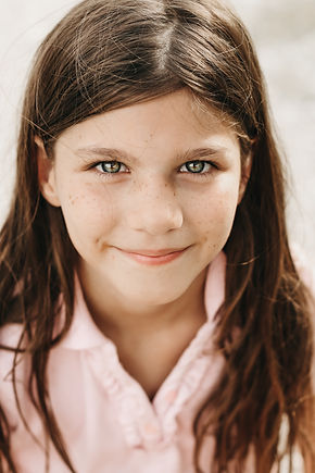 Young child looking at the camera with blue eyes