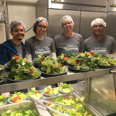 Volunteers cooking healthy meals at Haven Toronto, a MAZON Partner.
