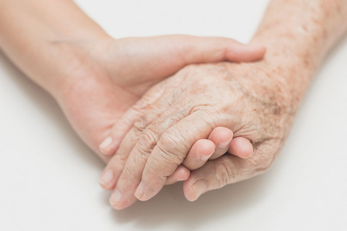 Image of close up of two hands holding