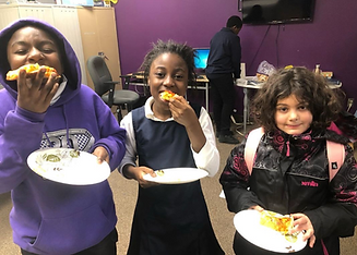 3 children eating snacks at a MAZON grantee