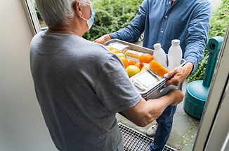Person delivering food to a senior