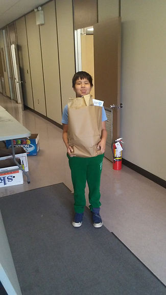 Student holding a paper bag filled with food