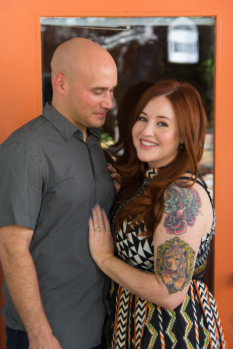 Man and tattooed woman pose in front of