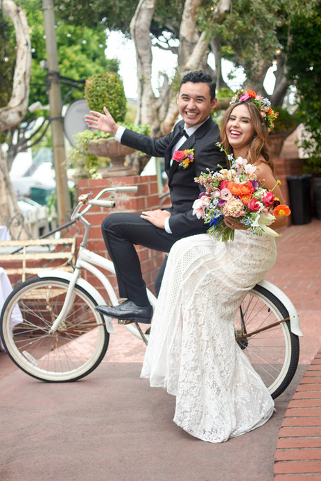 Newlywed couple poses together on vintag