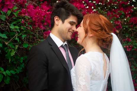 Bride and groom laugh and brush noses be