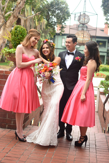 Married couple laughing with bridesmaids