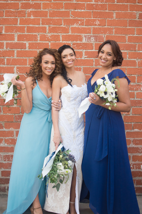 Bride and mismatched bridesmaids