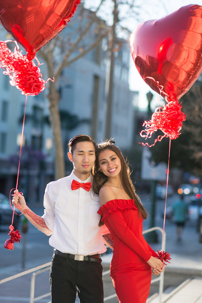 Couple with red heart balloons