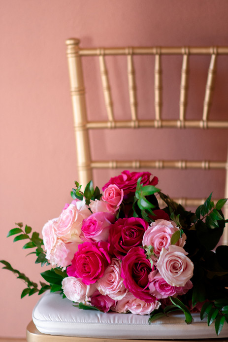 Vibrant pink flower bouquet on gold chai