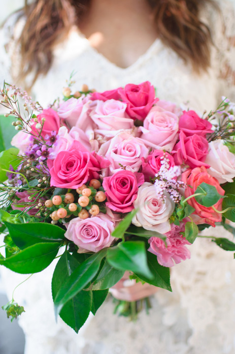 Brightly colored pink rose bouquet held