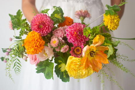 Vibrant yellow and pink bridal bouquet