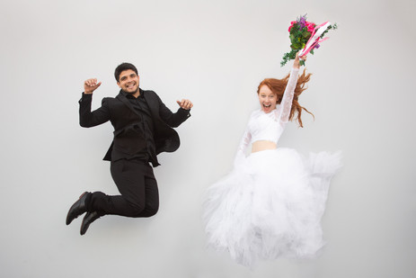 Bride and groom jump in the air in celeb