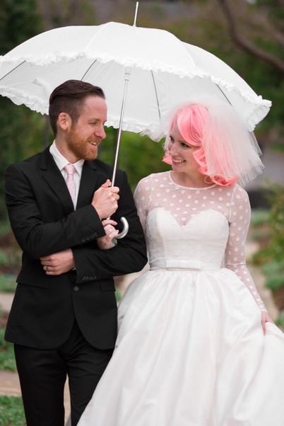 Vintage-inspired bride and groom under a
