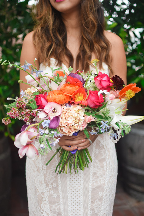 Colorful orange and pink bouquet held by