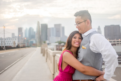 Couple hugs in front of downtown Los Ang
