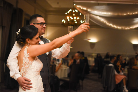 Bride and groom toast their guests at in