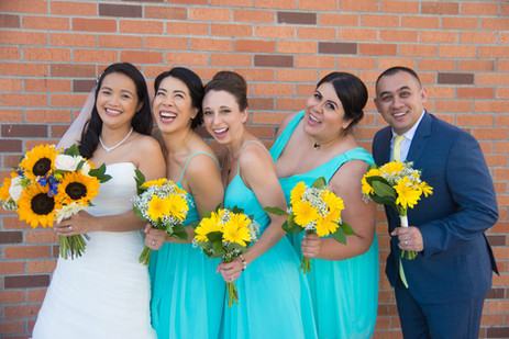 Mixed gender turquoise bridal party hold