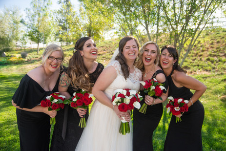 Bride laughing and posing with bridesmai