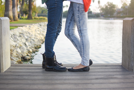 Close up of feet of kissing couple on do
