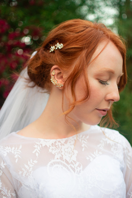 Close up of bride's hair and jewelry