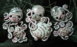 three_octopi_magnets_by_blackmagdalena-d54loml