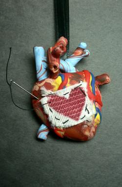 patch_up_my_heart_necklace_by_blackmagdalena
