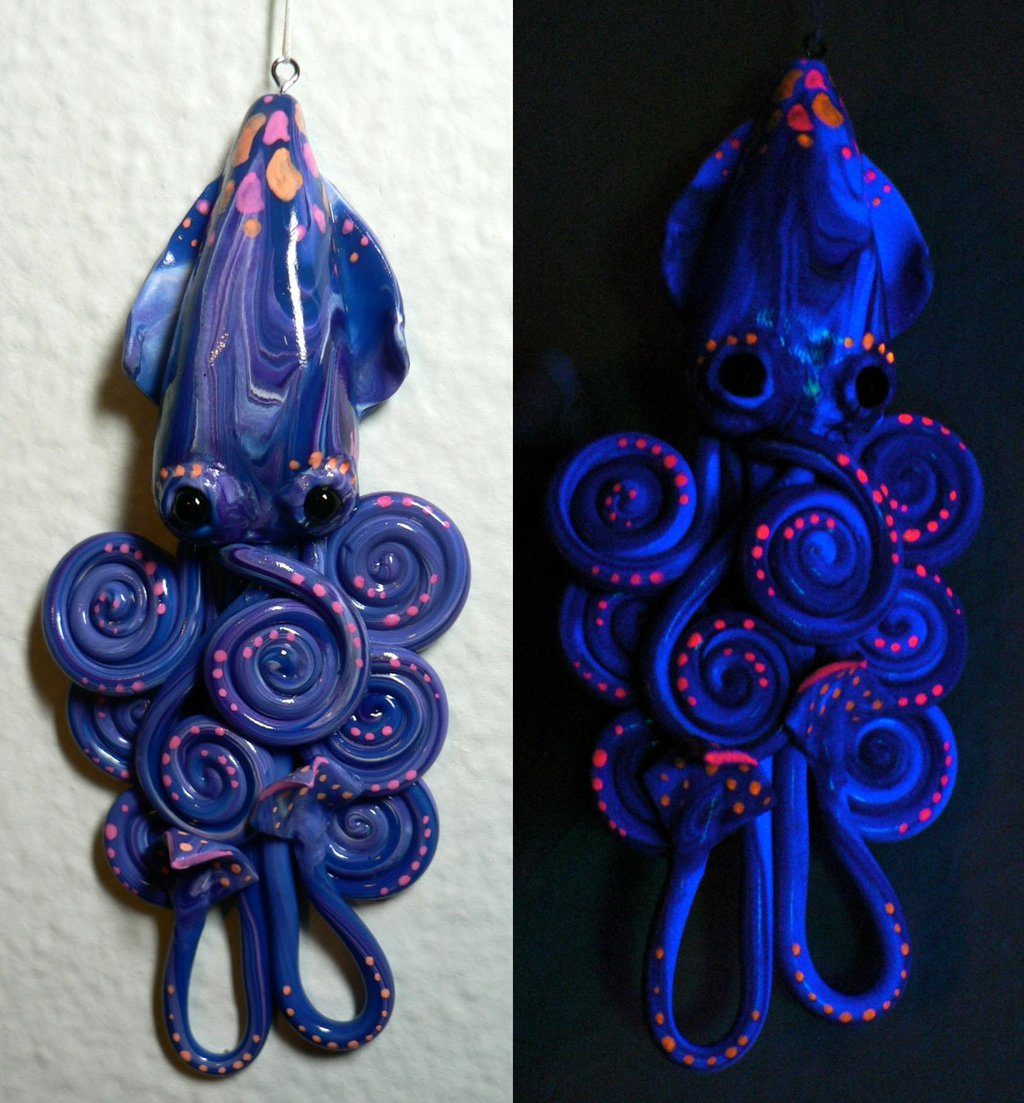 blue_squid_charm_by_blackmagdalena-d2o8qw9