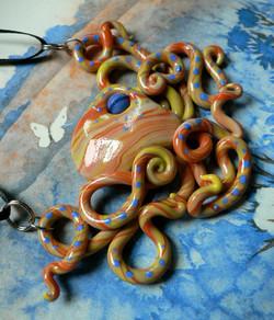 orange_and_blue_octopus_necklace_by_blackmagdalena-d4hhjoz