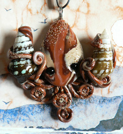 lake_barkley_squid_eating_snails_necklace_by_blackmagdalena-d4icpi7